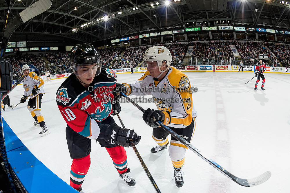 KELOWNA, CANADA - DECEMBER 3: Tyler Coulter #21 of the Brandon Wheat Kings checks Nick Merkley #10 of the Kelowna Rockets into the boards during first period on December 3, 2016 at Prospera Place in Kelowna, British Columbia, Canada.  (Photo by Marissa Baecker/Shoot the Breeze)  *** Local Caption ***