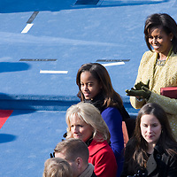 Michelle and Malia Obama watch Barack Obama arrive for his Inauguration as the 44th President of the United States of America. US Capitol, Washington, DC. 1/20/09. Photo by Lisa Quinones/Black Star.