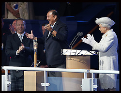 Image licensed to i-Images Picture Agency. 23/07/2014. Glasgow, United Kingdom. The Queen along with Commonwealth Games Federation President  Prince Imran and Sir Chris Hoy with the baton to officially open  the Commonwealth Games in Glasgow. Picture by Stephen Lock / i-Images