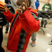 JERSEY CITY,NJ 29 JAN: Members of the Denver Broncos on the eve of their Superbowl debut join with the Knights of Columbus and the Jim and Linda Del Rio Foundation to distribute winter coats to underprivileged children at Sacred Heart RC School in Jersey City NJ.