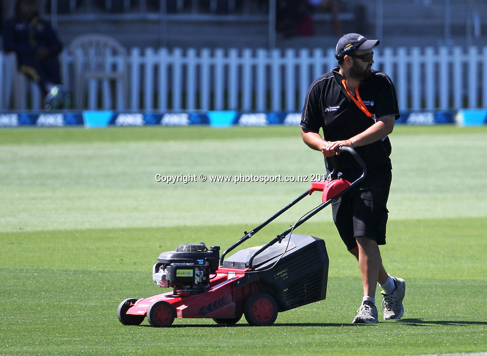 Groundsman brings a lawn mower onto the field after Ranaweera Eranga of Sri Lanka fell while bowling the first ball of his first over on Day 1 of the boxing Day Cricket Test Match  the Black Caps v Sri Lanka at Hagley Oval, Christchurch. 26 December 2014 Photo: Joseph Johnson / www.photosport.co.nz