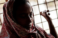 A young girl feel it's like being in jail not being able to get away from the cyclone center where they live very close.