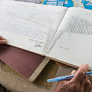 "George ""Kultura"" Thode is the Chief Ranger at Washington Slagbaai National Park. He has been working in the park for over 40 years. During this time, he has tracked and counted yellow-shouldered amazon parrots and other key species in the park. He has over 400 logbooks, like the one shown here) documenting his observations. Here, he shares a sketch he has made of one of the parrots."