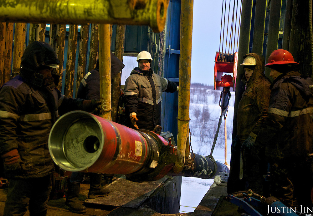 Workers drill at the Achimgaz gas drilling well in Novy Urengoi, Siberia, Russia.