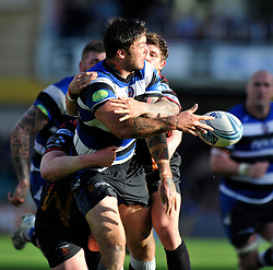 Bath centre Matt Banahan offloads the ball after being tackled - Photo mandatory by-line: Patrick Khachfe/JMP - Tel: Mobile: 07966 386802 19/10/2013 - SPORT - RUGBY UNION - Recreation Ground - Bath - Bath V Newport Gwent Dragons - Amlin Challenge Cup