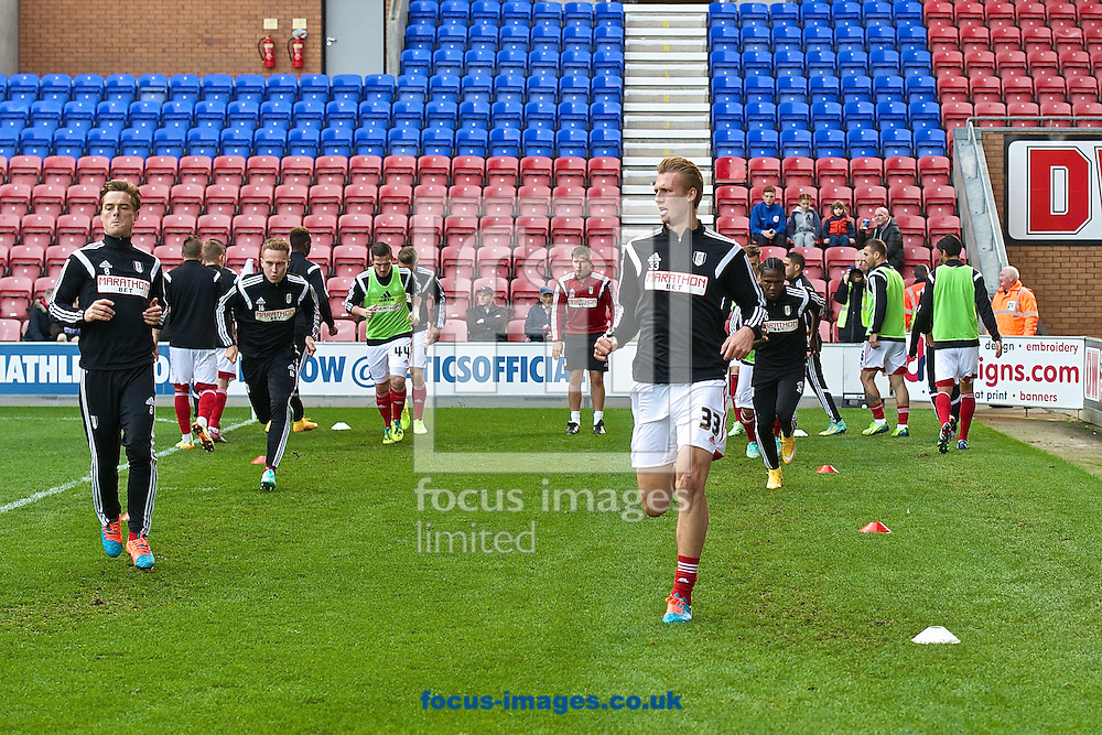 General view showing Fulham players led by Dan Burn (right) warming up pictured ahead of the Sky Bet Championship match at the DW Stadium, Wigan<br /> Picture by Ian Wadkins/Focus Images Ltd +44 7877 568959<br /> 01/11/2014