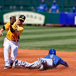 Mar 13, 2013; Bradenton, FL, USA; Toronto Blue Jays second baseman Emilio Bonifacio (1) steals second base past Pittsburgh Pirates shortstop Clint Barmes (12) during the top of the third inning of a spring training game at McKechnie Field. Mandatory Credit: Derick E. Hingle-USA TODAY Sports