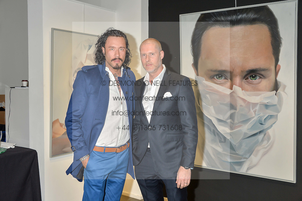 Left to right, Artist MIKE DARGAS and JEAN DAVID MALAT at a private view of woks by German artist Mike Dargas held at the Opera Gallery, 134 New Bond Street, London on 5th July 2016.