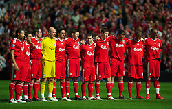 LIVERPOOL, ENGLAND - Sunday, April 11, 2010: Liverpool players observe a minutes silence to mark the 21st anniversary of the Hillsborough Stadium Disaster of the 15th April 1989, in which 96 Liverpool supporters lost their lives, before the Premiership match against Fulham at Anfield, the nearest game to the anniversary. (Photo by: David Rawcliffe/Propaganda)