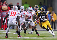 November 20 2010: Iowa Hawkeyes wide receiver Derrell Johnson-Koulianos (15) eyes Ohio State Buckeyes defensive back Orhian Johnson (19) during the third quarter of the NCAA football game between the Ohio State Buckeyes and the Iowa Hawkeyes at Kinnick Stadium in Iowa City, Iowa on Saturday November 20, 2010. Ohio State defeated Iowa 20-17.