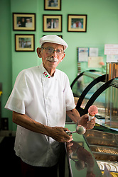 Carlos Cassasa, owner of La Fiorentina Gelateria, poses for a photograph at his store in Lima, Peru.