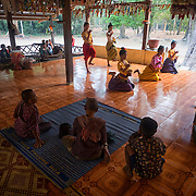 Young Khmer women dance at a small Buddhist temple near Bayon temple complex in Siem Reap, Cambodia.