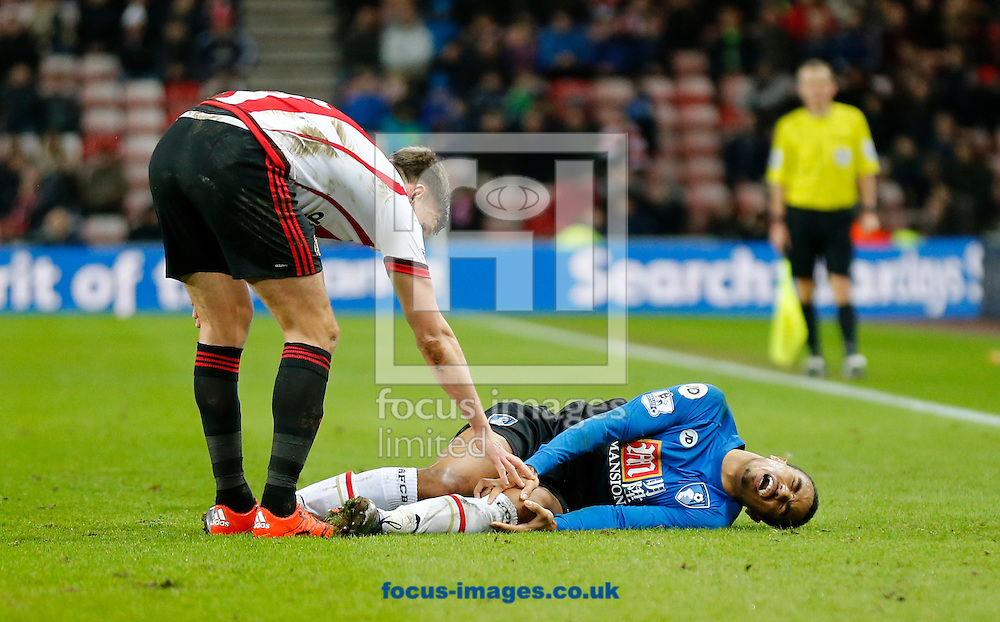 Billy Jones (l) of Sunderland apologizes after catching Junior Stanislas of Bournemouth during the Barclays Premier League match at the Stadium Of Light, Sunderland<br /> Picture by Simon Moore/Focus Images Ltd 07807 671782<br /> 23/01/2016