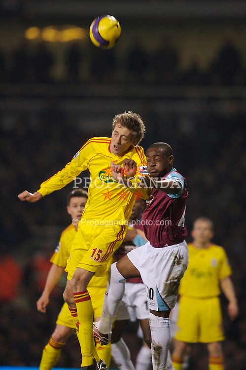 London, England - Tuesday, January 30, 2007: Liverpool's Peter Crouch and West Ham United's Nigel Reo-Coker during the Premiership match at Upton Park. (Pic by David Rawcliffe/Propaganda)