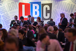© Licensed to London News Pictures . 26/03/2014 . London , UK . Journalists in the Spin Room at the venue , watch the debate . Liberal Democrat leader and Deputy Prime Minister , Nick Clegg and UKIP leader Nigel Farage , hold the first of two head to head debates on Britain's future in Europe , hosted by LBC Radio , at 8 Northumberland Avenue in London . Photo credit : Joel Goodman/LNP