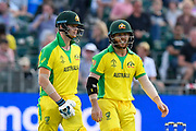 Steven Smith of Australia walks out to bat and is met by David Warner of Australia during the ICC Cricket World Cup 2019 match between Afghanistan and Australia at the Bristol County Ground, Bristol, United Kingdom on 1 June 2019.