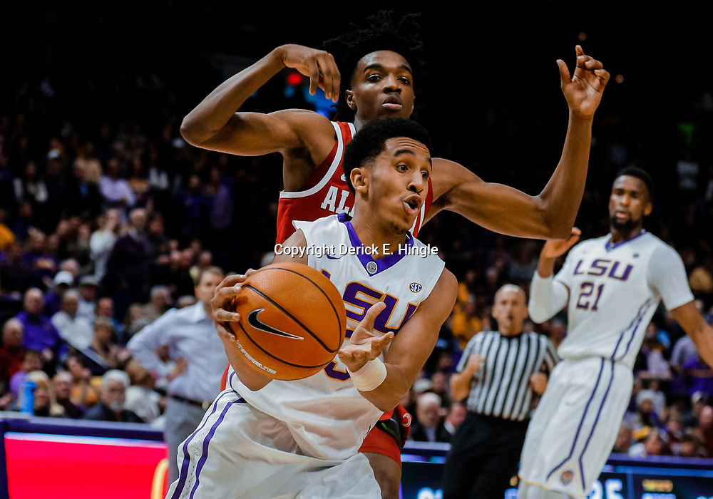 Jan 13, 2018; Baton Rouge, LA, USA; LSU Tigers guard Tremont Waters (3) drives past Alabama Crimson Tide guard Herb Jones (10) during the second half at the Pete Maravich Assembly Center. Alabama defeated LSU 74-66.  Mandatory Credit: Derick E. Hingle-USA TODAY Sports