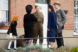 Civilian and military portrayed by Reenactors taking part in the Pickering 1940s war weekend  October 2009 Image Copyright Paul David Drabble