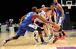 November 19, 2017 - Reno, Nevada, U.S - Reno Bighorns Guard DAVID STOCKTON (11) drives through Long Island Nets Guard MILTON DOYLE (35) and Long Island Nets Guard TAHJERE MCCALL (5) during the NBA G-League Basketball game between the Reno Bighorns and the Long Island Nets at the Reno Events Center in Reno, Nevada. (Credit Image: © Jeff Mulvihill via ZUMA Wire)