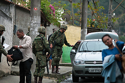 Sep 16, 2017 - Rio de Janeiro, Brazil - The army and special police forces begin Operation Double Dose to fight organized crime and drug trafficking. All of the favelas in the niteroi region were occupied by armed forces and residents were searched every time they leave or enter their neighborhood. About 2,600 members of the Armed Forces, 300 of the Civil Police and 250 of the Military Police participate. (Credit Image: © Humberto Ohana via ZUMA Wire)