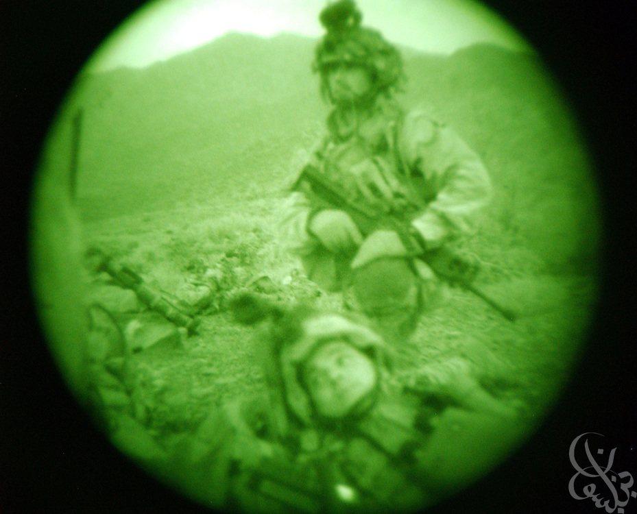 "US Army 101st Airborne 3-187 ""Bravo"" company soldiers (as seen with nightvision equipment) conduct a 23 July, 2002 sensitive site exploitation (SSE) mission after dark in the town of Narizah in Southeastern Afghanistan . The three day mission, intended to deny sanctuary to Al Qaida and Taliban fighters in villages along the Pakistan-Afghanistan border resulted in the recovery of several weapons caches and one Afghan detained for questioning."