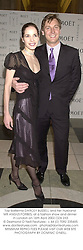 Top ballerina DARCEY BUSSELL and her husband MR ANGUS FORBES, at a fashion show and dinner in London on 16th April 2002.	OZA 233