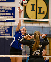 Interlakes Delaney Smith spikes the ball over the net with Prospect Mountain's Catie Leberman during NHIAA Division III volleyball on Monday evening.  (Karen Bobotas/for the Laconia Daily Sun)