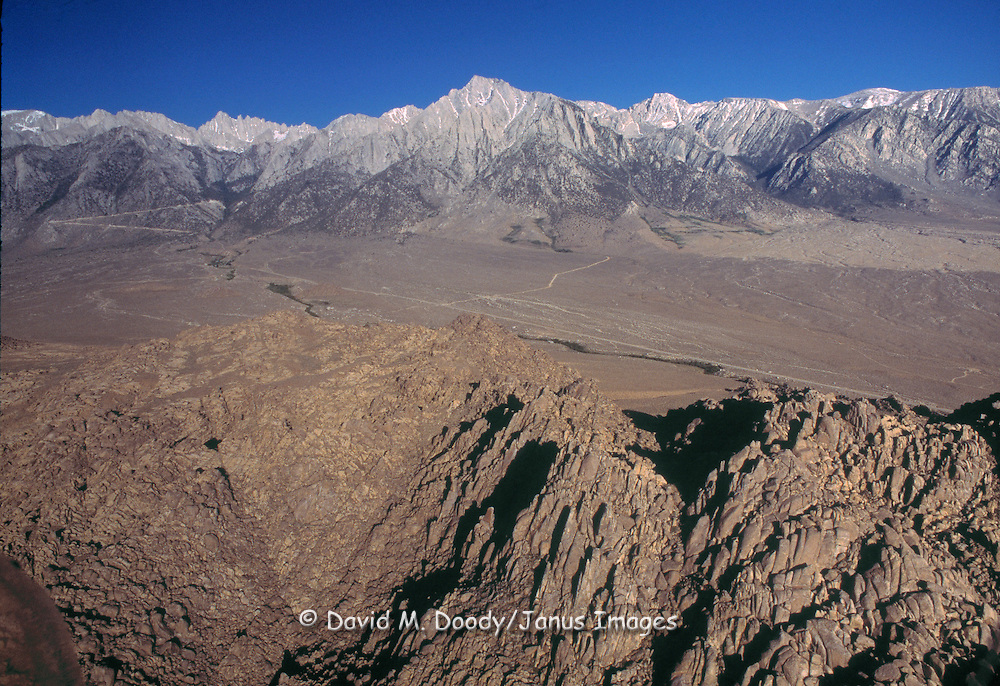 Aerial view of the Eastern Sierras and Mount Whitney with the Alabama Hills in the foreground near Lone Pine, California. © David M Doody