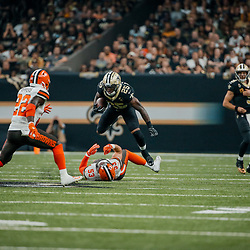 Sep 16, 2018; New Orleans, LA, USA; New Orleans Saints running back Mike Gillislee (25) breaks away from Cleveland Browns linebacker Joe Schobert (53) during the first quarter of a game at the Mercedes-Benz Superdome. Mandatory Credit: Derick E. Hingle-USA TODAY Sports