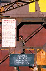 CHINA SHANGHAI NOV01 - Shanghai shipyard worker boards bulk freighter.. . jre/Photo by Jiri Rezac. . © Jiri Rezac 2001. . Contact: +44 (0) 7050 110 417. Mobile:  +44 (0) 7801 337 683. Office:  +44 (0) 20 8968 9635. . Email:   jiri@jirirezac.com. Web:     www.jirirezac.com