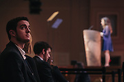 Carthage College student Dallas Nelson, watches the big screen as Jenna Haggar, a Republican member of the South Dakota House of Representatives, speaks during day two of the Conservative Political Action Conference (CPAC) at the Gaylord National Resort & Convention Center in National Harbor, Md.