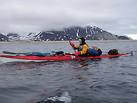 Kayaker passing by outside the Mitra peninsula on Spitzbergen