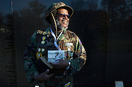 Vietnam war veteran Sgt. Bob Burton holds a photograph of himself as a young soldier back in 1967 as he visited the Vietnam Veterans Memorial early on Veterans Day, Friday, November 11, 2016, in Washington , DC. (Alan Lessig/Staff)