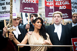 © Licensed to London News Pictures. 07/03/2014. Westminster, London, UK. 'Lady Justice' protesting with barristers against government-proposed legal aid cuts on Old Palace Yard as part of the Save UK Justice campaign. Photo credit : David Tett/LNP