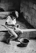 Araseli Garcia Figueroa, age 8, making a clay pot in the community center of her rural mountain village of El Limon, Honduras.