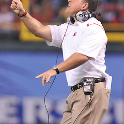 Dec 19, 2009; St. Petersburg, Fla., USA; Rutgers head coach Greg Schiano signals players during NCAA Football action in Rutgers' 45-24 victory over Central Florida in the St. Petersburg Bowl at Tropicana Field.
