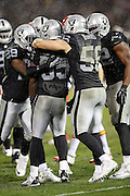Oakland Raiders outside linebacker Sio Moore (55) celebrates with teammates after stuffing a third down running play during the NFL week 12 regular season football game against the Kansas City Chiefs on Thursday, Nov. 20, 2014 in Oakland, Calif. The Raiders won their first game of the season 24-20. ©Paul Anthony Spinelli