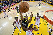 April 30, 2019; Oakland, CA, USA; Golden State Warriors guard Andre Iguodala (9) grabs a rebound against Houston Rockets guard Chris Paul (3) during the first half in game two of the second round of the 2019 NBA Playoffs at Oracle Arena. The Warriors defeated the Rockets 115-109.