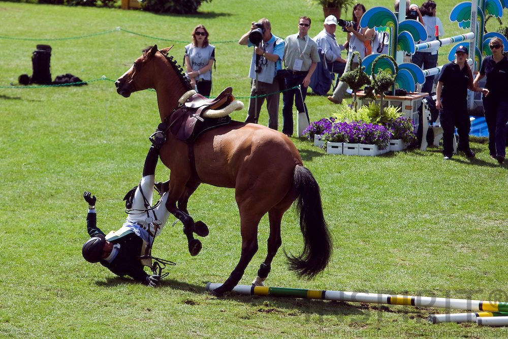 AACHEN - GERMANY - 04 JULY 2008 --  World Equestrian Festival, CHIO Aachen 2008 -- Brazilian Alvaro MIRANDA falling with his horse Ad Ornella trying to jump this fence during the Prize of Northrhine-Westphalia jumping competition of the World Equestrian Festival CHIO in Aachen. He got entangled with his foot caught in the stirrup and was taken to hospital by ambulance. The horse seemed to be fine after being calmed down. Photo: Erik Luntang..