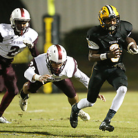 Ripley quarterback Trey Blanchard rushes past New Albany defenders during Friday night's game against New Albany.