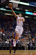Mar 15, 2017; Phoenix, AZ, USA; Phoenix Suns guard Devin Booker (1) lays up the ball against the Sacramento Kings in the first half at Talking Stick Resort Arena. Mandatory Credit: Jennifer Stewart-USA TODAY Sports
