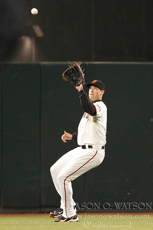 August 30, 2010; San Francisco, CA, USA;  San Francisco Giants left fielder Pat Burrell (9) catches a fly ball against the Colorado Rockies during the fifth inning at AT&T Park.  Colorado defeated San Francisco 2-1.