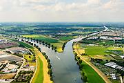 Nederland, Gelderland, Heumen, 26-06-2014; splitsing van de rivier de Maas met rechts het Maas-Waalkanaal, richting Nijmegen. Links Cuijk, het dorpje Heumen in het midden, recht Malden.<br /> Division of the river Meuse with to the right the Maas-Waal canal, direction Nijmegen. <br /> luchtfoto (toeslag op standaard tarieven);<br /> aerial photo (additional fee required);<br /> copyright foto/photo Siebe Swart.