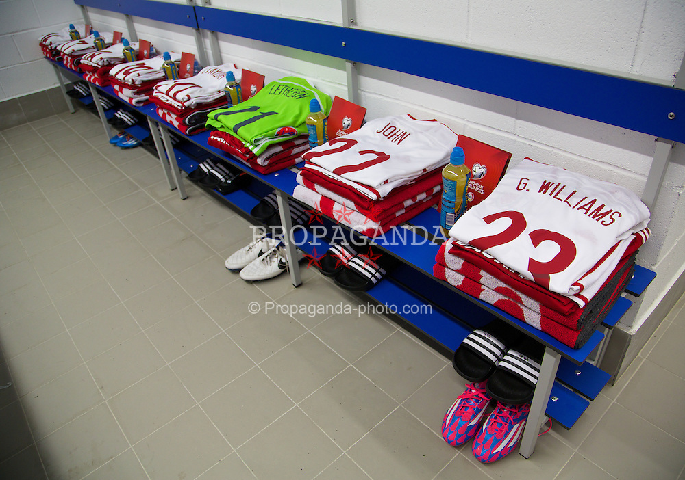 ANDORRA LA VELLA, ANDORRA - Tuesday, September 9, 2014: The Adidas shirts of Wales players laid out in the dressing room before the opening UEFA Euro 2016 qualifying match against Andorra at the Camp d'Esports del M.I. Consell General. (Pic by David Rawcliffe/Propaganda)