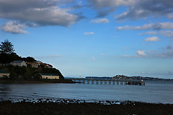 A pier extends out to Waitemata Harbour, at the base of North Head, Devonport, Auckland, New Zealand