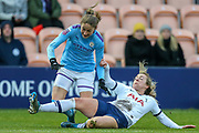 Tottenham Hotspur Women winger Gemma Davison (7) tackles Manchester City Women striker Janine Beckie (11) during the FA Women's Super League match between Tottenham Hotspur Women and Manchester City Women at the Hive, Barnet, United Kingdom on 5 January 2020.