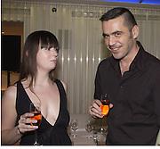 Avril Mair and Roland Mouret. I.D. magazine dinner for John Dempsey of Mac cosmetics, Fifth floor restaurant, Harvey Nichols. 17 December 2002. © Copyright Photograph by Dafydd Jones 66 Stockwell Park Rd. London SW9 0DA Tel 020 7733 0108 www.dafjones.com