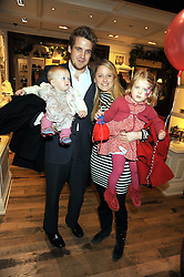 MR & MRS EDWARD LAWSON-JOHNSTON and their children LOLA-ROSE and GRACE at the launch of 'A Better World' a single by Laura Comfort held at the Ralph Lauren children's store, Old Brompton Road, London on 2nd December 2008.