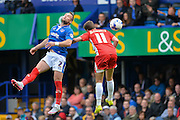 Ben Davies beats Sean McConville to the ball during the Sky Bet League 2 match between Portsmouth and Accrington Stanley at Fratton Park, Portsmouth, England on 5 September 2015. Photo by Adam Rivers.