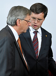 "Jean-Claude Juncker, Luxembourg's prime minister, left, speaks with Jan Peter Balkenende, the Dutch prime minister, during the ""Family Photo"" session at the European Summit, in Brussels, Belgium, Wednesday, Oct. 15, 2008.   (Photo © Jock Fistick)"
